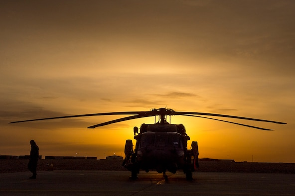 A U.S. Air Force HH-60G Pave Hawk sits on a landing pad during the sunrise on Camp Bastion, Afghanistan, March 11, 2013. The primary mission of the HH-60G Pave Hawk helicopter is to conduct day or night personnel recovery operations into hostile environments to recover isolated personnel. (U.S. Air Force photo/Tech. Sgt. Dennis J. Henry Jr.)