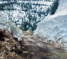The contractor had to clear 10-15 feet deep snow before being able to access the site.