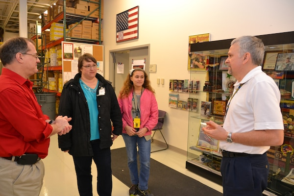 During a tour of the Middle East District, John Ballard (left) escorted the Neaverths to the USACE Deployment Center, where Keith Frye explained the purpose of the Deployment Center.