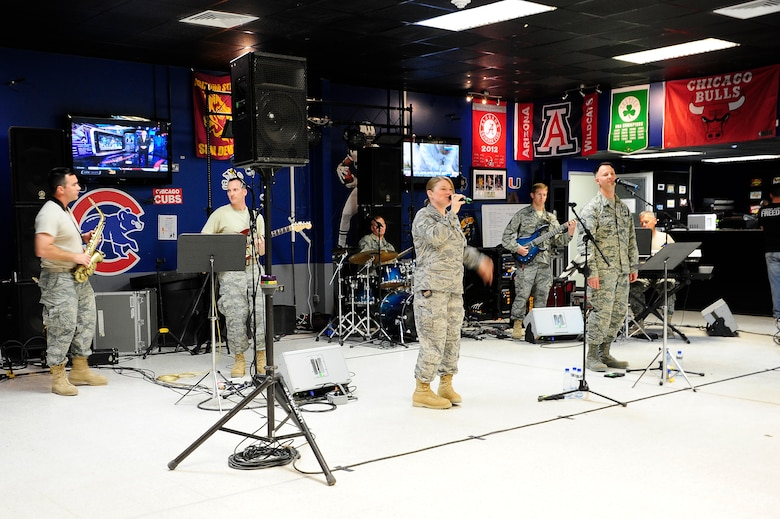 """The U.S. Air Forces Central Command Band """"Vector"""" performing for service members at 'The Rock' Drop Zone Mar 29, 2013. The AFCENT Band tours throughout the AOR to positively promote troop morale, diplomacy and outreach to host nation communities.(U.S. Air Force photo by Staff Sgt. Nicole Manzanares)"""