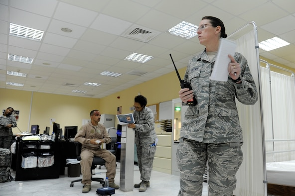 Col. Virginia Garner, 386th Expeditionary Medical Group, commander directs operations during a mass causality exercise at the 386th Air Expeditionary Wing, Southwest Asia Mar 26, 2013. (U.S. Air Force photo by Staff Sgt. Austin Knox)