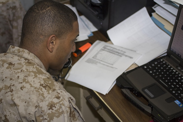 Sgt. Calvin Eberhardt, an administrative specialist assigned to the 26th Marine Expeditionary Unit (MEU), collects numbers for morning reports aboard the USS Kearsarge (LHD 3) while at sea, April 29, 2013. The 26th MEU is deployed to the 5th Fleet area of operations aboard the Kearsarge Amphibious Ready Group. The 26th MEU operates continuously across the globe, providing the president and unified combatant commanders with a forward-deployed, sea-based quick reaction force. The MEU is a Marine Air-Ground Task Force capable of conducting amphibious operations, crisis response and limited contingency operations. (U.S. Marine Corps photo by Cpl. Kyle N. Runnels/Released)
