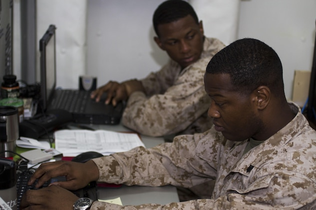 Sgt. Michael K. Burns and Cpl. Amadu Bah, administrative specialists assigned to the 26th Marine Expeditionary Unit (MEU), verify pay rosters aboard the USS Kearsarge (LHD 3) while at sea, April 29, 2013. The 26th MEU is deployed to the 5th Fleet area of operations aboard the Kearsarge Amphibious Ready Group. The 26th MEU operates continuously across the globe, providing the president and unified combatant commanders with a forward-deployed, sea-based quick reaction force. The MEU is a Marine Air-Ground Task Force capable of conducting amphibious operations, crisis response and limited contingency operations. (U.S. Marine Corps photo by Cpl. Kyle N. Runnels/Released)