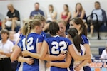 Members of the 2012 All-Air Force Womens Volleyball team huddle up before match play.