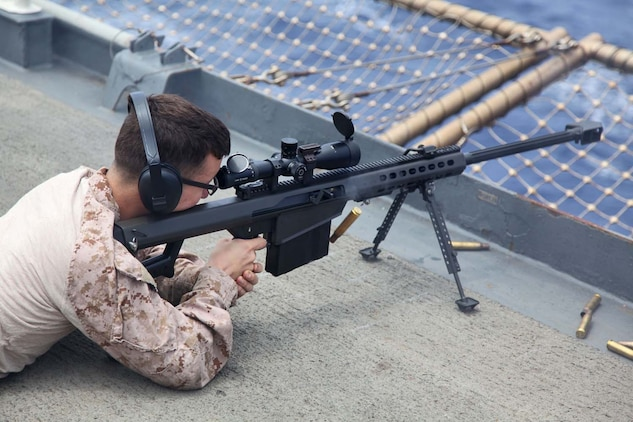 USS RUSHMORE (April 29, 2013) Lance Cpl. Richard Deeg, military policeman, Military Police Detachment, Combat Logistics Battalion 15, 15th Marine Expeditionary Unit, fires a Special Application Scoped Rifle during a live-fire exercise on the flight deck of USS Rushmore, April 29. The servicemembers fired more than 14,000 rounds to ensure everyone was proficient with all of the battalion's weapon systems. The 15th MEU is comprised of approximately 2,400 Marines and sailors and is deployed as part of the Peleliu Amphibious Ready Group. Together, they provide a forward-deployed, flexible sea-based Marine Air Ground Task Force capable of conducting a wide variety of operations ranging from humanitarian aid to combat. Deeg, 22, is from San Diego. (U.S. Marine Corps photo by Cpl. Timothy Childers/Released)