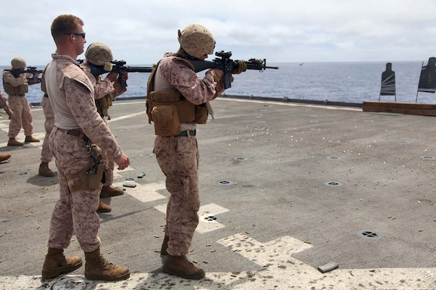 130429-M-VZ265-133 USS RUSHMORE (April 29, 2013) Marines assigned to Combat Logistics Battalion 15, 15th Marine Expeditionary Unit, fire M16 and M4 service rifles during a live-fire exercise on the flight deck of USS Rushmore, April 29. The servicemembers fired more than 14,000 rounds to ensure everyone was proficient with all of the battalion's weapon systems. The 15th MEU is comprised of approximately 2,400 Marines and sailors and is deployed as part of the Peleliu Amphibious Ready Group. Together, they provide a forward-deployed, flexible sea-based Marine Air Ground Task Force capable of conducting a wide variety of operations ranging from humanitarian aid to combat. (U.S. Marine Corps photo by Cpl. Timothy Childers/Released)
