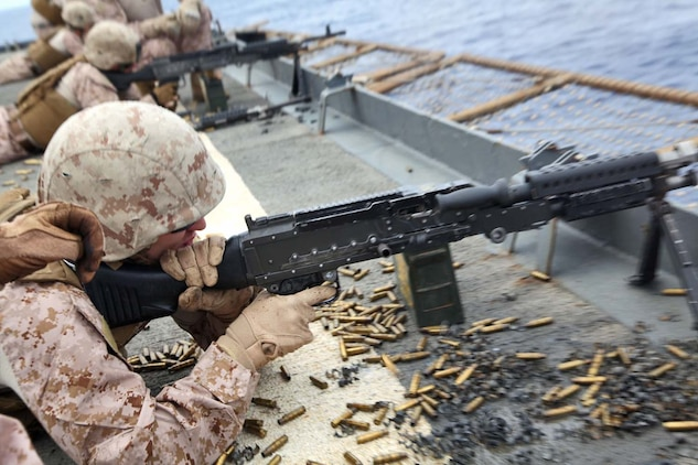 USS RUSHMORE (April 29, 2013) Corporal Josh B. Wright, light armored vehicle mechanic, Maintenance Detachment, Combat Logistics Battalion 15, 15th Marine Expeditionary Unit, fires a M240B machine gun during a live-fire exercise on the flight deck of USS Rushmore, April 29. The servicemembers fired more than 14,000 rounds to ensure everyone was proficient with all of the battalion's weapon systems. The 15th MEU is comprised of approximately 2,400 Marines and sailors and is deployed as part of the Peleliu Amphibious Ready Group. Together, they provide a forward-deployed, flexible sea-based Marine Air Ground Task Force capable of conducting a wide variety of operations ranging from humanitarian aid to combat. Wright, 24, is from Jasper, Ga. (U.S. Marine Corps photo by Cpl. Timothy Childers/Released)