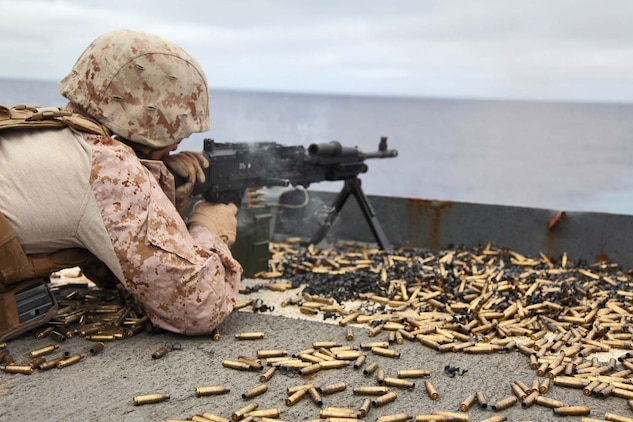 USS RUSHMORE (April 29, 2013) A Marine assigned to Combat Logistics Battalion 15, 15th Marine Expeditionary Unit, fires a M240B machine gun during a live-fire exercise on the flight deck of USS Rushmore, April 29. The servicemembers fired more than 14,000 rounds to ensure everyone was proficient with all of the battalion's weapon systems. The 15th MEU is comprised of approximately 2,400 Marines and sailors and is deployed as part of the Peleliu Amphibious Ready Group. Together, they provide a forward-deployed, flexible sea-based Marine Air Ground Task Force capable of conducting a wide variety of operations ranging from humanitarian aid to combat. (U.S. Marine Corps photo by Cpl. Timothy Childers/Released)