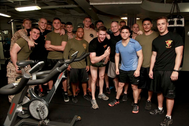 USS PELELIU (April 27, 2013) Marines with Kilo Company, Battalion Landing Team 3/5, 15th Marine Expeditionary Unit, pose for a photo  at the end of the first night's Campbell Cup held in the gym of USS Peleliu, April 27. The challenge was the final competition of the Campbell Cup, a competition that brought teams from within the 15th Marine Expeditionary Unit and Peleliu Amphibious Ready Group against each other. This two-night event pitted the Command Element's team against Kilo Company's team in a showdown for the coveted Campbell Cup. The 15th MEU is deployed as part of the Peleliu Amphibious Ready Group and is comprised of approximately 2,400 Marines and sailors. Together with Amphibious Squadron Three, they provide a forward-deployed, flexible sea-based Marine Air Ground Task Force capable of conducting a wide variety of operations ranging from humanitarian aid to combat. (U.S. Marine Corps photo by Cpl. John Robbart III/Released)