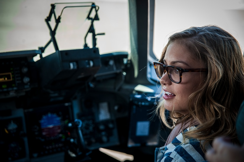 "Army Wives actress Elle McLemore sits in the cockpit of a C-17 Globemaster III during a tour of the aircraft April 26, 2013, at Joint Base Charleston –Air Base, S.C. Army Wives tells the story of four women and one man who are brought together by their common bond - they all have military spouses. The series is based on the book ""Under the Sabers: The Unwritten Code of Army Wives"" by Tanya Biank and is produced by ABC Television Studio and The Mark Gordon Company. (U.S. Air Force photo/Senior Airman Dennis Sloan)"