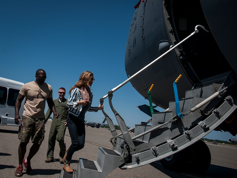 "Army Wives cast members Joshua Henry and Elle McLemore board a C-17 Globemaster III during a tour of the aircraft April 26, 2013, at Joint Base Charleston –Air Base, S.C. Army Wives tells the story of four women and one man who are brought together by their common bond - they all have military spouses. The series is based on the book ""Under the Sabers: The Unwritten Code of Army Wives"" by Tanya Biank and is produced by ABC Television Studio and The Mark Gordon Company. (U.S. Air Force photo/Senior Airman Dennis Sloan)"