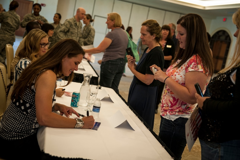 "Actress Brooke Shields, from the television show Army Wives, signs an autograph for a military spouse during a meet and greet session April 26, 2013, at the Charleston Club on Joint Base Charleston – Air Base, S.C. Army Wives tells the story of four women and one man who are brought together by their common bond - they all have military spouses. The series is based on the book ""Under the Sabers: The Unwritten Code of Army Wives"" by Tanya Biank and is produced by ABC Television Studio and The Mark Gordon Company. (U.S. Air Force photo/Senior Airman Dennis Sloan)"