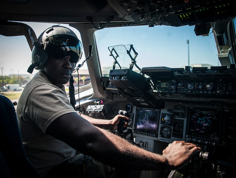 "Army Wives actor Joshua Henry sits in the cockpit of a C-17 Globemaster III during a tour of the aircraft April 26, 2013, at Joint Base Charleston –Air Base, S.C. Army Wives tells the story of four women and one man who are brought together by their common bond - they all have military spouses. The series is based on the book ""Under the Sabers: The Unwritten Code of Army Wives"" by Tanya Biank and is produced by ABC Television Studio and The Mark Gordon Company. (U.S. Air Force photo/Senior Airman Dennis Sloan)"