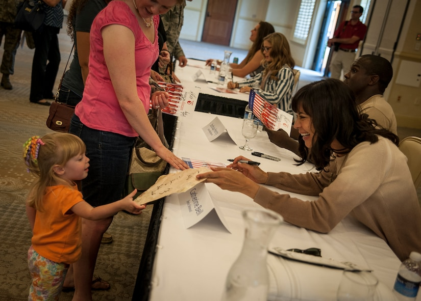 "Actress Catherine Bell, from the television show Army Wives, signs an autograph during a meet and greet session April 26, 2013, at the Charleston Club on Joint Base Charleston – Air Base, S.C.  Army Wives tells the story of four women and one man who are brought together by their common bond - they all have military spouses. The series is based on the book ""Under the Sabers: The Unwritten Code of Army Wives"" by Tanya Biank and is produced by ABC Television Studio and The Mark Gordon Company. (U.S. Air Force photo/Senior Airman Dennis Sloan)"