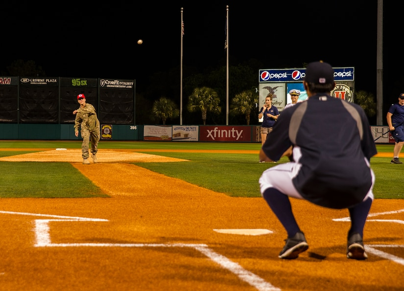 Staff Sgt. Kelly Brown, 560th Red Horse Squadron structures engineer, throws out the first pitch of the Charleston RiverDogs Military Appreciation Night game April 25, 2013, at the Joseph P. Riley, Jr. Park in Charleston, S.C. The Charleston RiverDogs hosted Military Appreciation night to show their support for the local military. (U.S. Air Force photo/ Senior Airman George Goslin)