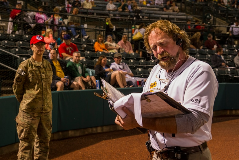 Ken Carrington, Charleston RiverDogs announcer, pays tribute to the military personnel during the Charleston RiverDogs Military Appreciation Night game April 25, 2013, at the Joseph P. Riley, Jr. Park in Charleston, S.C. The Charleston RiverDogs hosted Military Appreciation night to show their support for the local military. (U.S. Air Force photo/ Senior Airman George Goslin)
