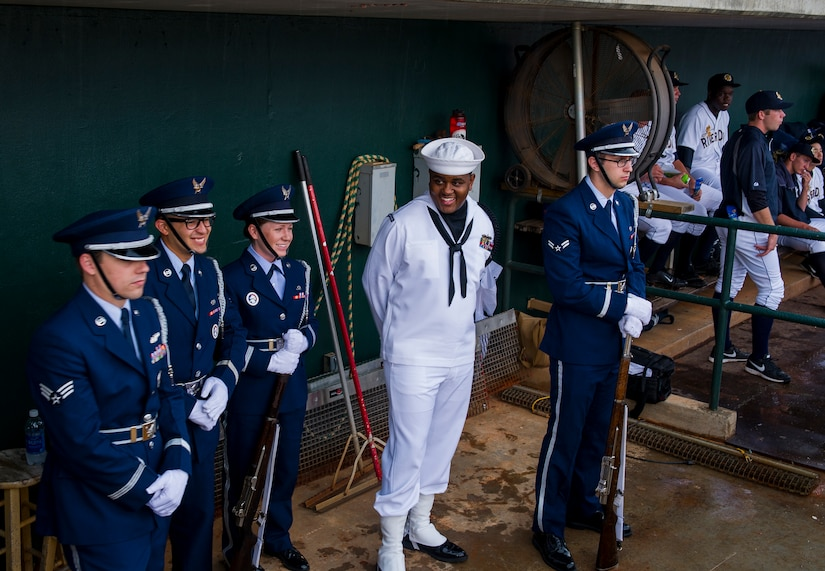Members of the Joint Base Charleston Honor Guard wait for a rain delay to end during the Charleston RiverDogs Military Appreciation Night game April 25, 2013, at the Joseph P. Riley, Jr. Park in Charleston, S.C. The Charleston RiverDogs hosted Military Appreciation night to show their support for the local military. (U.S. Air Force photo/ Senior Airman George Goslin)