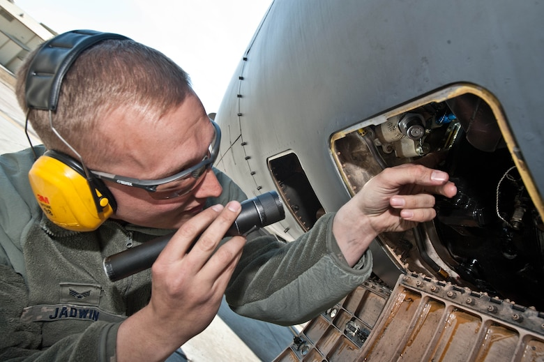 Senior Airman Brandon Jadwin, 28th Aircraft Maintenance Squadron electrical and environmental technician, checks the inside of an access panel to inspect an integrated drive generator system on a B-1 bomber at Ellsworth Air Force Base, S.D., April 4, 2013. Electrical and Environmental technicians inspect and evaluate B-1 bombers to determine the operational status of assigned assets. (U.S. Air Force photo by Airman 1st Class Zachary Hada/Released)