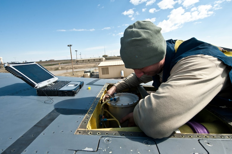 Staff Sgt. Thomas Gillan, 28th Aircraft Maintenance Squadron electrical and environmental lead technician, inspects electrical systems on top of a B-1 bomber at Ellsworth Air Force Base, S.D., April 4, 2013. Aircraft electrical and environmental systems specialists are one of six specialties in the 28th AMXS specialist section responsible for making sure the many systems of the B-1s at Ellsworth function properly. (U.S. Air Force photo by Airman 1st Class Zachary Hada/Released)