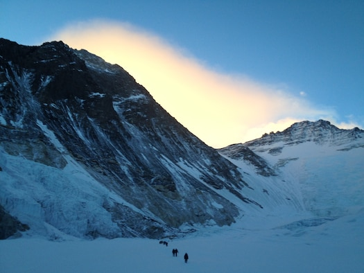 Early Morning Photo of Everest from Camp 2 Walking to Camp 1 (black pyramid on left). (Photo courtesy of USAF 7 Summits Team)