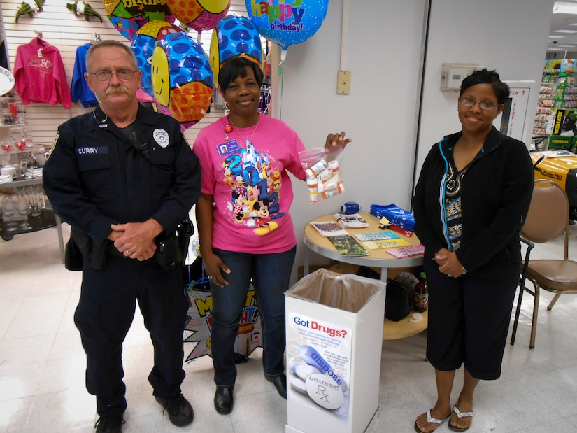 Officer Kevin Curry, a member from the 628th Security Forces Squadron, (middle) Carol Lampkin-Harris, a member of the 628th Medical Group Drug Demand Reduction Program, and (right) Master Sgt. Anitra Towns, 628th MDG noncommissioned officer in charge of pharmacy services, collect medication during the last Drug Enforcement Administration National Prescription Drug Take Back Day April 27, 2013, in the Navy Exchange at Joint Base Charleston – Weapons Station, S.C. The National Prescription Drug Take Back Day aims to provide a safe, convenient, and responsible means of disposal of prescription medicines, while also educating the general public about the potential for abuse of these medications. The JB Charleston – Air Base and Weapons Station collected more than 75 pounds of unwanted/expired prescription medications. (U.S. Air Force photo/Staff Sgt. Anthony Hyatt)