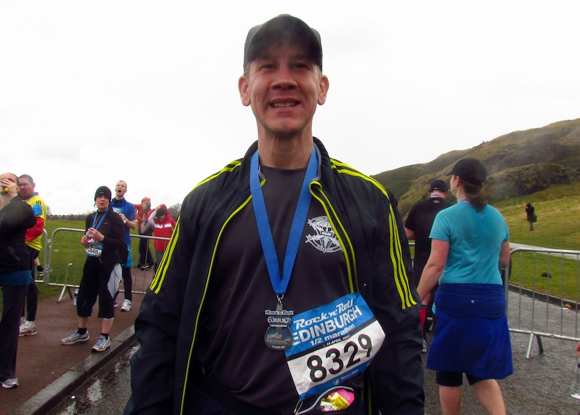 Master Sgt. Brion Rockel, 100th Operations Support Squadron Weather flight chief, wears his medal after running the 2013 Rock-n-Roll Half-Marathon in Edinburgh, Scotland. Several Airmen competed in the 13.1-mile event battling heavy winds, near-freezing temperatures and pelting rain. Rockel finished the race in 2 hours, 10 minutes. (Courtesy photo/Released)