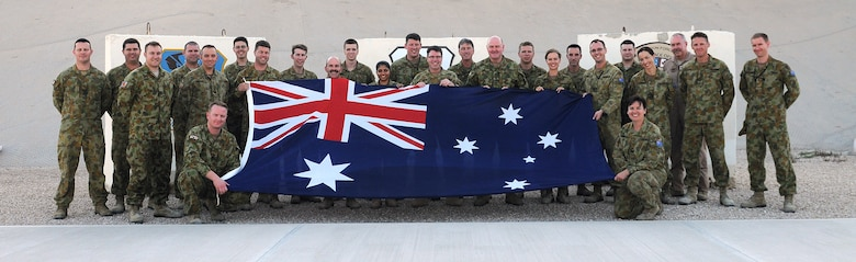 609th Air and Space Operations Center Royal Australian Air Force contingent pose for a photo March 17 at an undisclosed location Southwest Asia. (U.S. Air Force photo by Tech. Sgt. Raymond Hoy)