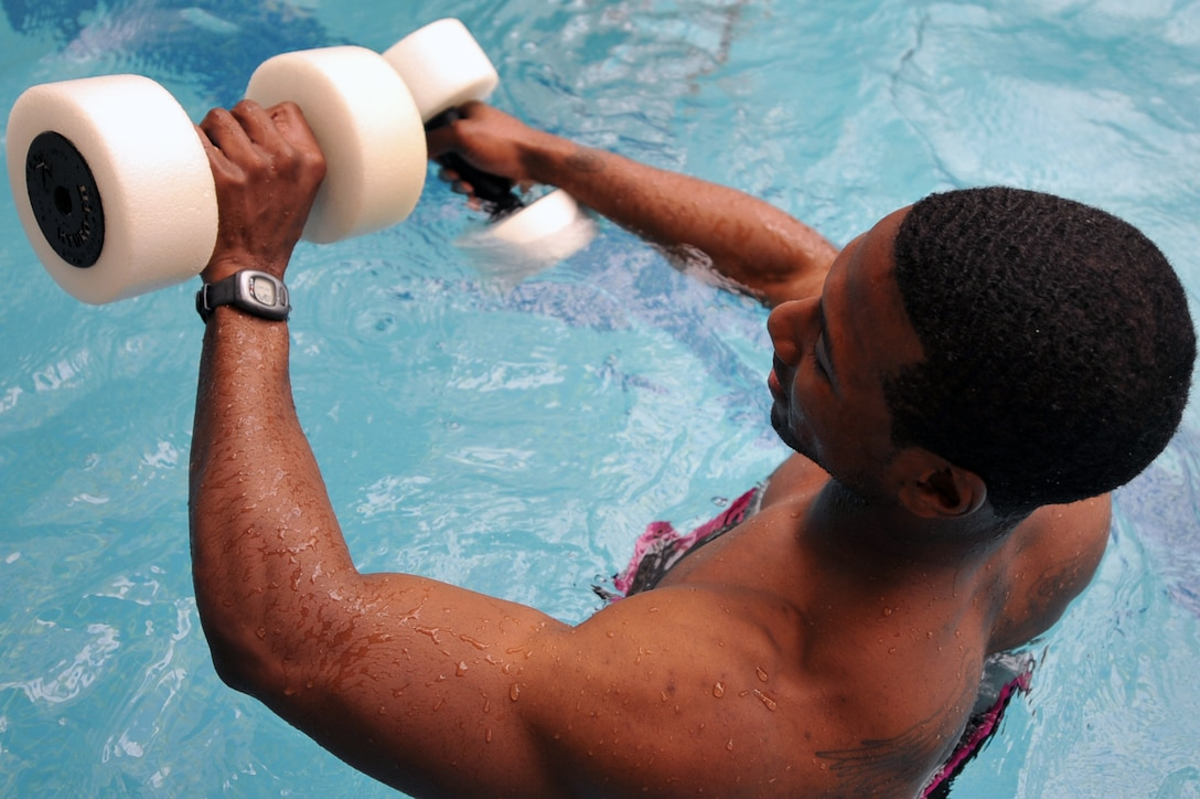 Staff Sgt. Derek McGee, 51st Medical Group public health technician, checks his heart rate after a minute-long underwater sprint during a water-jogging class at the base pool on Osan Air Base, Republic of Korea, April 29, 2013. Participants wore water-resistant heart-rate monitors during the workout to monitor how hard they were working. (U.S. Air Force photo/Senior Airman Alexis Siekert)
