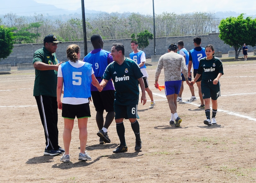 Honduran and Joint Task Force-Bravo officers shake hands after a soccer match during a day of friendly competitions at the annual Camaraderie Day event, April 26. The Honduran military team beat the Americans 2-1 and took home the overall championship trophy.(Photo by Ana Fonseca)