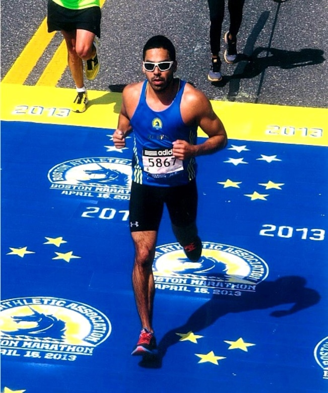 Captain Ruben Arredondo, SMC Global Positioning Systems Directorate, crosses the finish line at the Boston Marathon, April 15. (Courtesy photo)