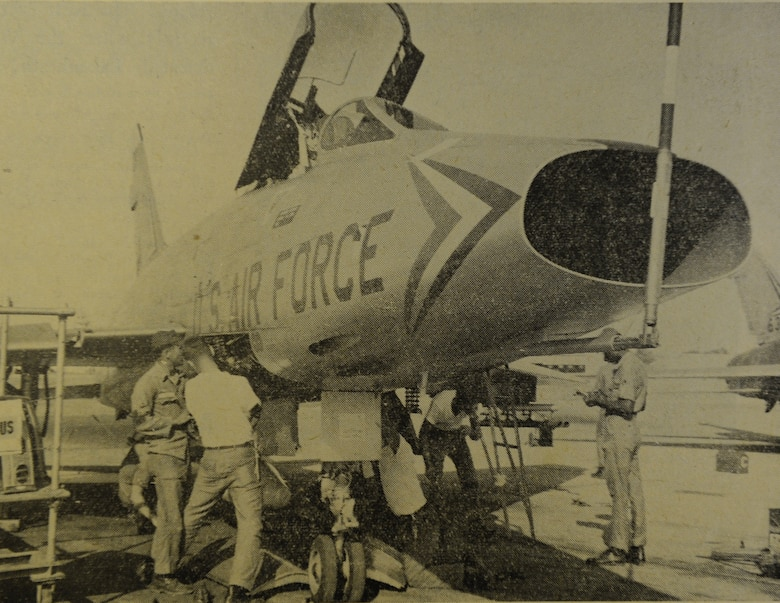 WHEELUS AB, Libya - Two teams of specialists clear and load an F-100 aircraft with weapons. Team members (left to right) are A1C Charles Aldridge, A3C Robert Bates, A1C Darwin Anderson and SSgt. Jesse Crowe.