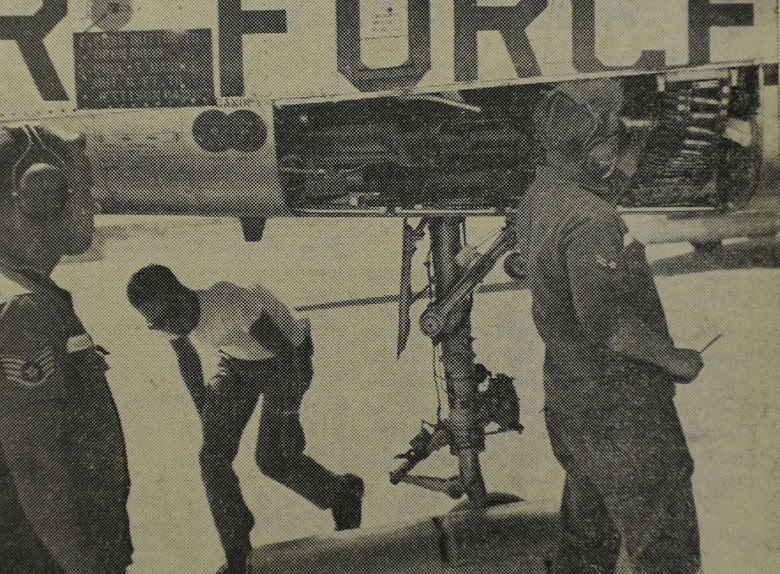 WHEELUS AB, Libya - SSgt. Earl Hendrix and A2C John Soper arm an F-100 aircraft preparing for a mission over El Uotia range. These members of the 348th Munitions Maintenance Squadron are assigned to the 48th's Det. 1.