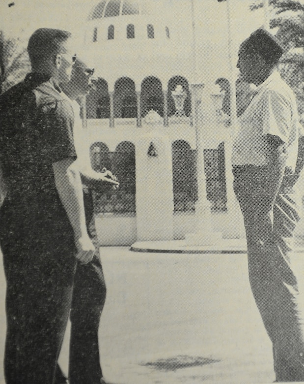 WHEELUS AB, Libya - Members of the 48th's Det. 1 at Wheelus AB, Libya ask questions of a Libyan guide on their tour of Tripoli. In the background is the palace of His Majesty King Idris I. The ruler of Libya has another palace in Torbruk.