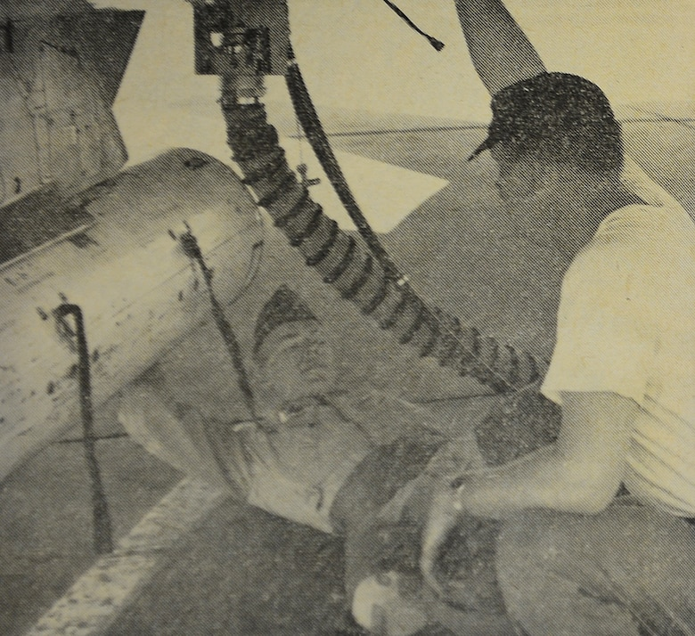 WHEELUS AB, Libya - 1st Lt. John Miko (left) of the 494th Fighter Squadron watches over the bomb loading of an F-100 aircraft with SSgt. Gerald McKinney, a member of the 348th Munitions Maintenance Squadron.