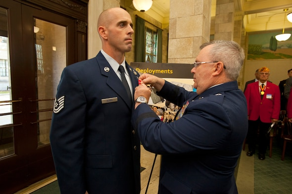 New Jersey Air National Guard Tech. Sgt. Michael Sears, left, is awarded the Bronze Star by Brig. Gen. Michael L. Cunniff, the adjutant general, at a ceremony April 17, 2013, at the State House in Trenton, N.J. On a single combat patrol in Afghanistan, Sears, an explosive ordnance disposal technician with the 177th Fighter Wing, defused two improvised explosive devices and made five trips across open terrain under heavy enemy fire to aid a wounded coalition soldier and to engage insurgent forces. Sears suffered shoulder injury and expended more than 190 rounds from his M4 rifle during the firefight. He was also awarded the Purple Heart. (U.S. Air National Guard photo by Master Sgt. Mark C. Olsen/Released)