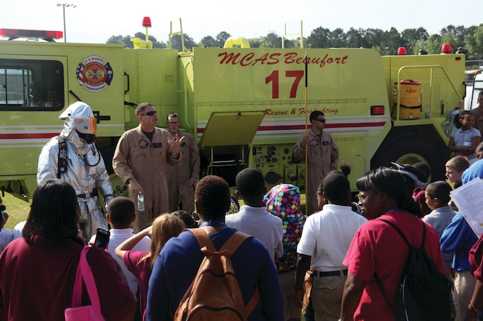 Aircraft Rescue and Fire Fighting Marines from Marine Corps Air Station Beaufort educate students on the various tools they use if a fire occurred, including their air tanks, protective gear and fire truck during Science, Technology, Engineering and Mathematics Day at Battery Creek High School, April 25. STEM Day educates students on the various uses of science, technology, engineering and mathematics in different career fields.