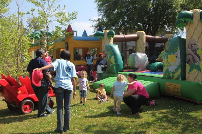 Bouncy houses filled with giggling children covered the lawn outside during the Fun Day Carnival at the Child Development Center aboard Marine Corps Air Station Beaufort, April 26. The Fun Day Carnival serves as a fun event to end the Month of the Military Child and thank military children for their sacrifices.