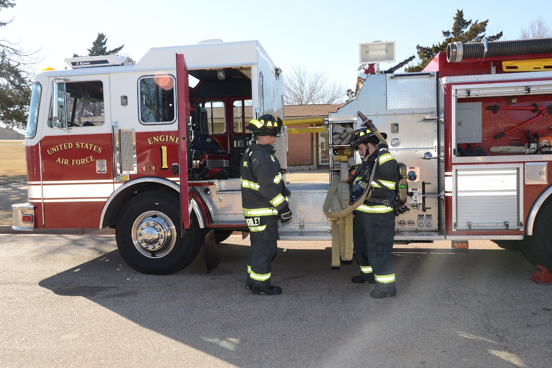 Members of Tinker's Fire and Emergency Services Division practice fire drills at least once a week, varying the level of difficulty, the size of crews they use and the size of building in which they will be working.  (Air Force photo by Kelly White)