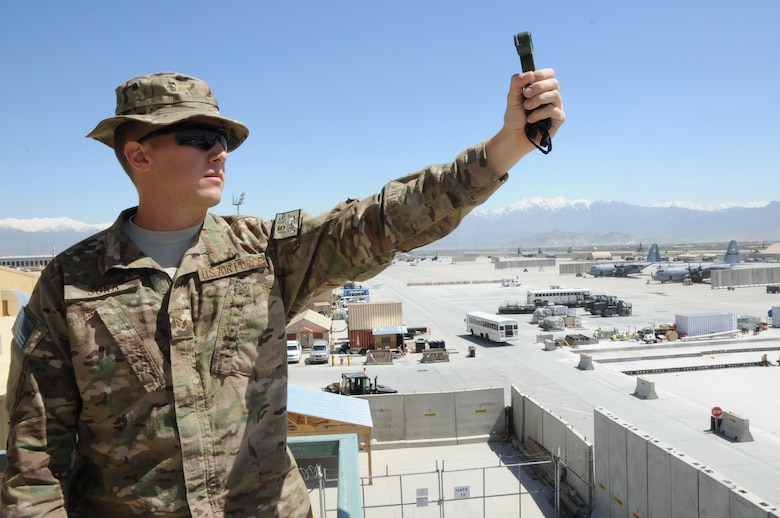 Senior Airman Zachary Sura, 455th Expeditionary Operations Support Squadron weather forecaster, uses a handheld weather tracker on Bagram Airfield, Afghanistan, May 1, 2013. The handheld tracker measures temperature, dew point and other meteorological data in the event the main weather radar system is unavailable. (U.S. Staff Sgt. David Dobrydney)