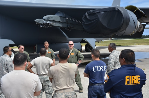 Capt. Chad Davis, 23rd Expeditionary Bomb Squadron instructor pilot, briefs 36th Civil Engineer Squadron Andersen Fire and Emergency Services members on safety procedures involving the B-52 Stratofortress on Andersen Air Force Base, Guam, April 30, 2013. The training covered various safety mishaps associated with the B-52 and allowed members from the 23rd EBS and the 36th CES to share best practices regarding aircraft safety. (U.S. Air Force photo by Staff Sgt. Veronica McMahon/Released)
