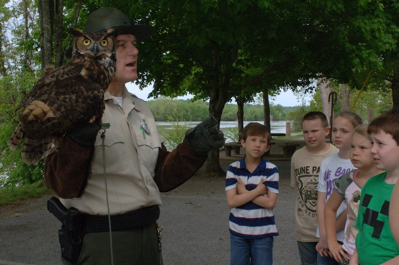 Montgomery Bell State Park Ranger Tim Wheatley shows and tells about the Great Horned Owl during the Cheatham Lake Environmental Awareness Day May 2, 2013 at Cheatham Lake in Ashland City, Tenn. The U.S. Army Corps of Engineers Nashville District organized the event where students from West Cheatham Elementary School learned about various environmental topics in an outdoors setting.