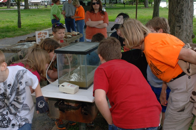 Conservation volunteers from Cheatham, Davidson and Robinson Counties show students from West Cheatham County Elementary School a tank with tadpoles and other water creatures during Environmental Awareness Day May 2, 2013 at Cheatham Lake in Ashland City, Tenn. Park rangers with the U.S. Army Corps of Engineers Nashville District organized and sponsored the event.