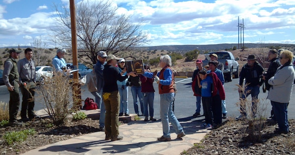 ABIQUIU LAKE, N.M., -- Katherine Eagleson, director of the Espanola Wildlife Center, shares about the kestrel to volunteers at Abiquiu Lake's Earth Day event, April 20, 2013.