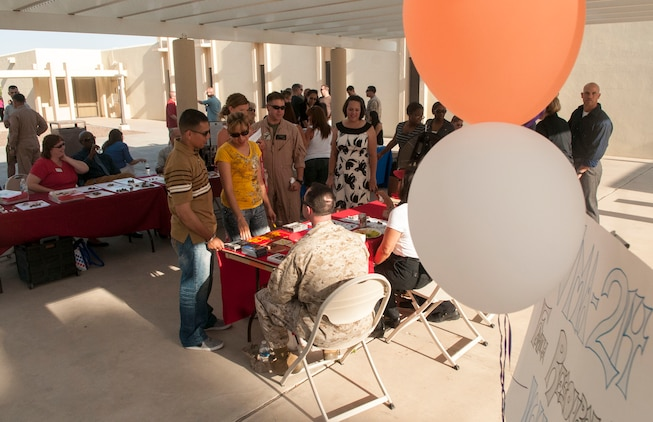 Marines, Sailors and family members of Marine Attack Squadron 214, Marine Attack Squadron 211, Marine Attack Squadron 311 and Marine Aviation Logistics Squadron 13 were brought together for a cross-squadron pre-deployment brief and family barbecue at Marine Corps Air Station Yuma's base chapel courtyard, May 1. The event included a resource fair for Marines and families looking for information on what they can count on from station support groups.