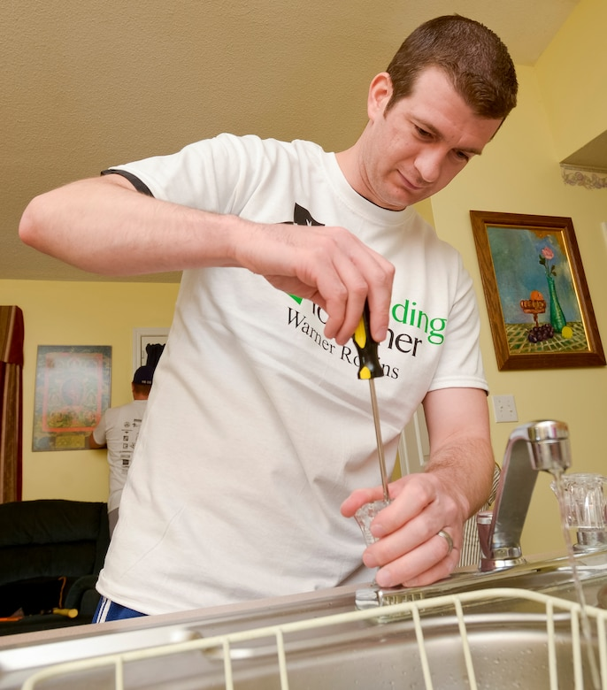 U.S. Air Force Tech. Sgt. Patrick Sweeney, from the 116th Air Control Wing, Georgia Air National Guard, repairs a kitchen sink at a local home, Warner Robins, Ga., April 27, 2013.  Sweeney and four other Airmen from the wing, volunteered with the Rebuilding Together Warner Robins non-profit organization to provide free home repairs to a local low-income household.  (U.S. Air National Guard photo by Master Sgt. Roger Parsons/Released)