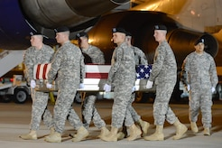 A U.S. Army carry team transfers the remains of Pfc. Charles P. McClure of Stratford, Okla., during a dignified transfer May 4, 2013 at Dover Air Force Base, Del. McClure was assigned to 4th Battalion, 42nd Field Artillery Regiment, 1st Combat Team, 4th Infantry Division, Ft. Carson, Colo. (U.S. Air Force photo/Greg L. Davis)