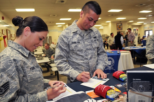 U.S. Air Force Staff Sgt. Emily Young and Senior Airman Adrian Hamilton, both with the 151st Air Refueling Wing, fill out questionnaires for the USAA representative at a resource fair for members of the Utah Air National Guard Base in Salt Lake City Utah, May 4, 2013. (U.S. Air National Guard photo by TSgt. Jeremy Giacoletto-Stegall)(RELEASED)