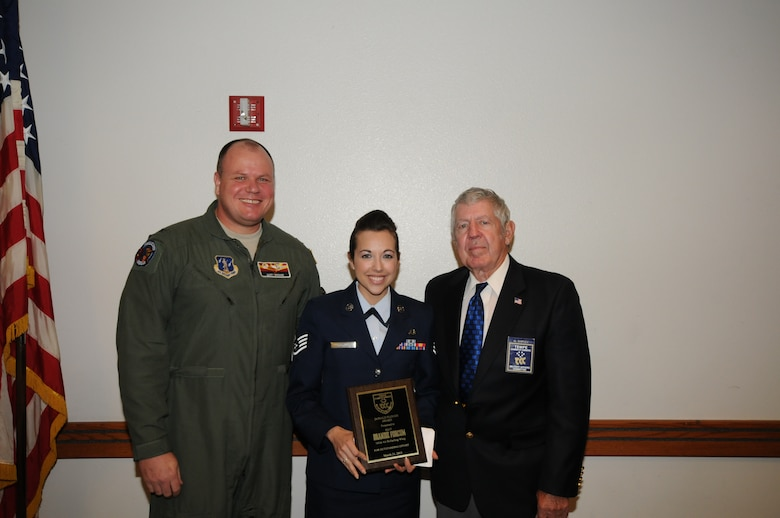 U.S. Air Force Col. Gary Brewer, 161st Air Refueling Wing commander; and Al Shipley, Tempe Military Affairs Committee chair; present Staff Sgt. Brandie Forcum, 161 ARW command post, with the Tech. Sgt. Donald Plough award during a ceremony March 21, 2013. Formed more than 30 years ago to honor military members of Arizona Guard and Reserve units, the Tempe Military Affairs Committee conducts luncheons to present awards to outstanding officer and enlisted personnel. The 161 ARW award was named for Tech. Sgt. Donald Plough who lost his life when a KC-135 crashed in March 1982. (U.S. Air National Guard photo by Master Sgt. Kelly Deitloff/Released)