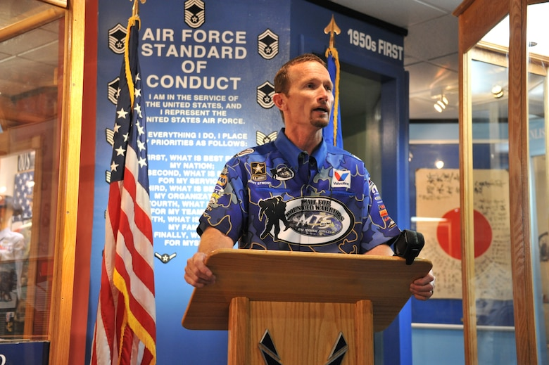 National Hot Rod Association Funny Car champion Jack Beckman speaks about being added to the U.S. Air Force Enlisted Heritage Hall's Wall of Achievers May 2 at Gunter Annex. Beckman joins a notable list of former enlisted Airmen who have received the honor, including former President George W. Bush, retired Brig. Gen. Chuck Yeager, Johnny Cash and actors Gene Autry and Charlton Heston.  (U.S. Air Force photo by Staff Sgt. Sandi Percival)