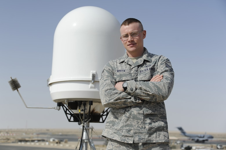 """Senior Airman Erik White, 386th Expeditionary Operations Support Squadron, performs his duty as a weather forecaster next to the wings newly installed portable Doppler radar at the 386th Air Expeditionary Wing, Southwest Asia May 4, 2013. White was awarded this weeks """"Rock Solid Warrior"""" designation by the 386th Top 3 Council.  White's job is to accurately predict the weather based on current conditions and weather models. """"We have less information to work with out here and we have to get back to using some of our fundamental weather forecasting techniques to ensure accurate forecasts. In weather moisture plays a major role in what type of weather is seen or not seen."""" (U.S Air Force photo by Staff Sgt. Austin Knox)"""